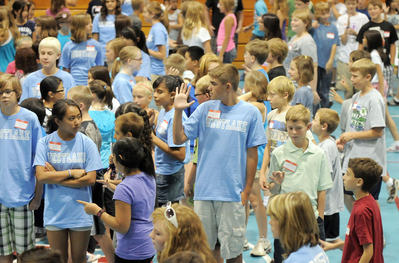 sixth graders walk past their 8th grade leaders during an exercise in the gym at Westlake Middle School for the 6th grade orientation on Thursday.<br /> August 11, 2011<br /> staff photo/ David R. Jennings