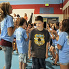 Sean Bohling walks through a gauntlet of cheering 8th graders as he enters the gym during Westlake Middle School's 6th grade orientation on Thursday.<br /> August 11, 2011<br /> staff photo/ David R. Jennings