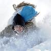 "Maci Triezenberg, 11, hangs on to Jimi Misztal as they go down ""hospital hill"" near Oak Circle and Miramonte Blvd. on Saturday.<br /> February 4, 2012<br /> staff photo/ David R. Jennings"