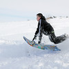 "Grant Misztal, 11, gets some air while sledding down ""hospital hill"" near Oak Circle and Miramonte Blvd. on Saturday.<br /> February 4, 2012<br /> staff photo/ David R. Jennings"
