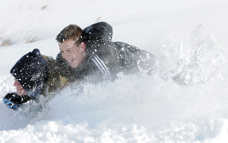 """Jimi Misztal sleds down """"hospital hill"""" with his son Grant, 11, on Saturday near Oak Circle and Miramonte Blvd.<br /> February 4, 2012<br /> staff photo/ David R. Jennings"""