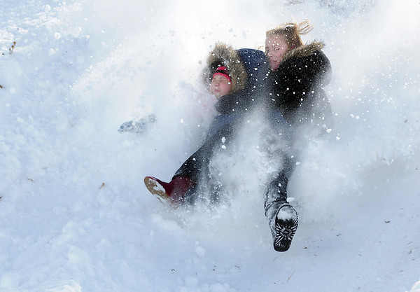 """Makenna Wagner, 10, left, and Kaylie Hayes, 12, slide down """"hospital hill"""" after loosing their sled on Saturday near Oak Circle and Miramonte Blvd.<br /> February 4, 2012<br /> staff photo/ David R. Jennings"""