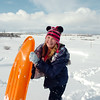 "Makenna Wagner,10, smiles after sledding down ""hospital hill""  on Saturday. Wagner said that it was fun even though her face was ""frozen"".<br /> February 4, 2012<br /> staff photo/ David R. Jennings"