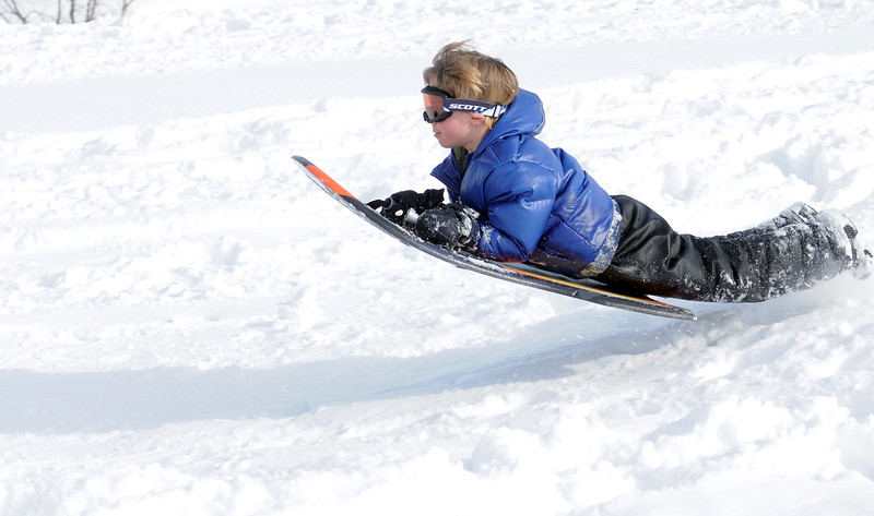 """Riley Petrone, 6, gets air while sledding down """"hospital hill"""" near Oak Circle and Miramonte Blvd. on Saturday.<br /> February 4, 2012<br /> staff photo/ David R. Jennings"""