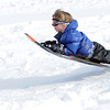"Riley Petrone, 6, gets air while sledding down ""hospital hill"" near Oak Circle and Miramonte Blvd. on Saturday.<br /> February 4, 2012<br /> staff photo/ David R. Jennings"