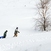 """Grant Misztal, 11, left, and his father Jimi make the hike back up  """"hospital hill"""" after a sledding run on Saturday.<br /> February 4, 2012<br /> staff photo/ David R. Jennings"""