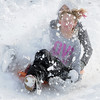 "Kaylie Hayes, 12, front, and Maddie Wagner, 11, get snow in their faces as they slide down ""hospital hill"" near Oak Circle and Miramonte Blvd. on Saturday.<br /> February 4, 2012<br /> staff photo/ David R. Jennings"