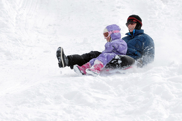 Laurie Petrone and her daughter Addison, 4, sled down the hill near Oak Circle and Miramonte Blvd. on Saturday.<br /> February 4, 2012<br /> staff photo/ David R. Jennings