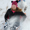 "Makenna Wagner, 10, left, and Maci Triezenberg, 11, get snow in their faces as they slide down ""hospital hill"" near Oak Circle and Miramonte Blvd. on Saturday.<br /> February 4, 2012<br /> staff photo/ David R. Jennings"