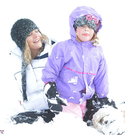 Tina Cartelli and her daughter Isabella, 4, recover after sledding down the hill near Oak Circle and Miramonte Blvd. on Saturday.<br /> February 4, 2012<br /> staff photo/ David R. Jennings