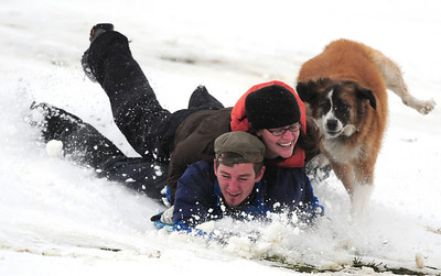 Snowedit003.jpg Jon Estep, 26, of Boulder, at left, Amanda Fox, 22, of Boulder, and Mesa, the dog, speed down a hill while sledding at Tantra Park in Boulder on Thursday, Oct. 29. Photo by Jeremy Papasso/ For The Camera
