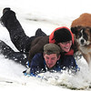 Snowedit003.jpg Jon Estep, 26, of Boulder, at left, Amanda Fox, 22, of Boulder, and Mesa, the dog, speed down a hill while sledding at Tantra Park in Boulder on Thursday, Oct. 29.<br /> Photo by Jeremy Papasso/ For The Camera