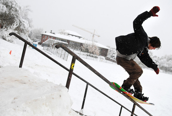 Snowedit005.jpg Shake Junt, 19, of Boulder, lays down a tail press 50/50 grind on a hand-rail at New Vista High School in Boulder on Thursday, Oct. 29. <br /> Photo by Jeremy Papasso/ For The Camera