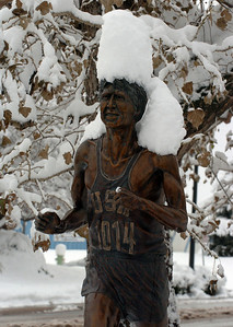 Frank must be getting cold. Snow collects on the Frank Shorter statue near Folsom Field on Thursday. Cliff Grassmick / October 29, 2009
