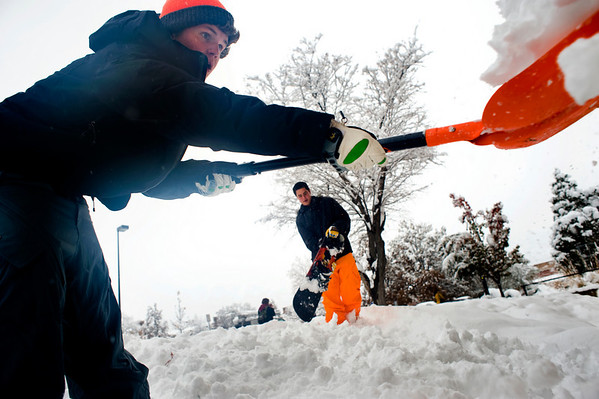 Freshmen Ted Schmitt (left) and Alex Strellov build a fort outside the Libby dormitories on the University of Colorado campus in Boulder, Thursday, Oct. 29th, 2009. Boulder saw 17 inches by Thursday morning, and expected up to 10 more inches by the end of the day.  <br /> KASIA BROUSSALIAN / THE CAMERA