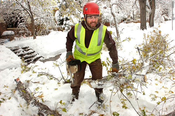 SNOW72.JPG <br /> Ken Fisher a Forestry Assistant with the city of Boulder, finishes up clearing up a downed branch on University Hill in Boulder on Thursday morning.<br /> PHoto by Paul Aiken / The Camera Oct 29