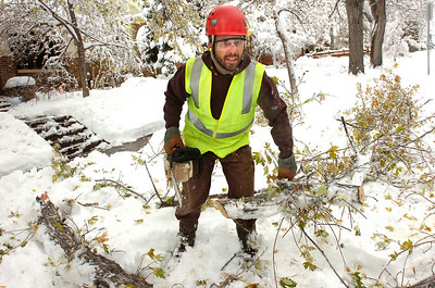 SNOW72.JPG  Ken Fisher a Forestry Assistant with the city of Boulder, finishes up clearing up a downed branch on University Hill in Boulder on Thursday morning. PHoto by Paul Aiken / The Camera Oct 29