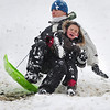 Snowedit006.jpg Brian Rocheleau, 32, of Boulder, and Robert Romero, 7, of Boulder, brace for impact after hitting a jump on a sled at Tantra Park in Boulder on Thursday, Oct. 29.
