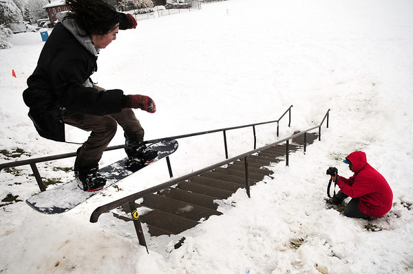 Snow006.jpg Shake Junt, 19, of Boulder, at left, slides a hand-rail while his friend James Carey, 18, of Boulder, photographs him at New Vista High School in Boulder on Thursday, Oct. 29. <br /> Photo by Jeremy Papasso/ For The Camera