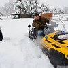SNOW106<br /> Matt Muir, left, and Scott Raderstorf, volunteers with Boulder Nordic Sport, prepare their snowmobile and grooming apparatus at North Boulder Park on Thursday.<br /> Photo by Marty Caivano/Camera/Oct. 29, 2009
