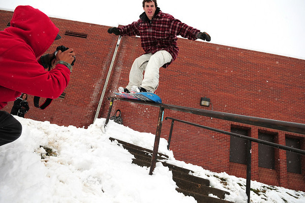Snowedit004.jpg James Carey, of Boulder, at left, snaps a photograph of his friend Andrew Egan, of Boulder, as he slides a hand-rail at New Vista High School in Boulder on Thursday, Oct. 29.<br /> Photo by Jeremy Papasso/ For The Camera