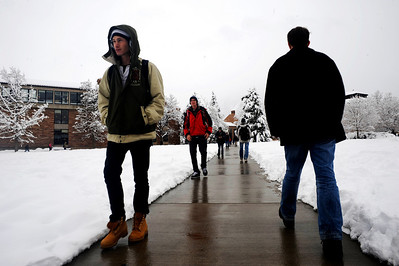Students walk through Norlin Quad on the University of Colorado campus in Boulder, Thursday, Oct. 29th, 2009. Boulder saw 17 inches by Thursday morning, and expected up to 10 more inches by the end of the day.   KASIA BROUSSALIAN / THE CAMERA