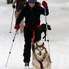 Fria the dog pulls owner Sarah Orobona as she skis in North Boulder Park on Thursday.<br /> Cliff Grassmick / October 29, 2009