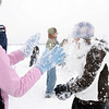 Sarah Hughes, 15, left, pelts Emma Leenerman, 16, with snow during the snowball fight organized by Broomfield High School students at the Broomfield County Commons on Thursday<br /> <br /> October 29, 2009<br /> Staff photo/David R. Jennings