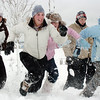Gloria Fuhrman, 17, left, Emma Leenerman, 16, Elizabeth Belton, 16, and Brittaey Zec, 15, lead an attack on some boys during the snowball fight organized by Broomfield High School students at the Broomfield County Commons on Thrusday<br /> <br /> October 29, 2009<br /> Staff photo/David R. Jennings