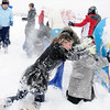 Skyler Ellis, 15, center, tries to take the fort of sleds during the snowball fight organized by Broomfield High School students at the Broomfield County Commons on Thursday<br /> <br /> October 29, 2009<br /> Staff photo/David R. Jennings