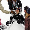 Isaac Wilson, 15, is buried into the waist in snow during the snowball fight organized by Broomfield High School students at the Broomfield County Commons on Thrusday<br /> <br /> October 29, 2009<br /> Staff photo/David R. Jennings