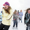Elizabeth Belton, 16, left, and Abbey Kochevar 15, try to avoid being hit by snowballs during the snowball fight organized by Broomfield High School students at the Broomfield County Commons on Thursday<br /> <br /> October 29, 2009<br /> Staff photo/David R. Jennings