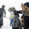 Skyler Ellis, 15, center, gets a face of snow from Abbey Kochevar, 15, during the snowball fight organized by Broomfield High School students at the Broomfield County Commons on Thursday<br /> <br /> October 29, 2009<br /> Staff photo/David R. Jennings