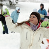 Kayleen Campbell, 16, throws a snowball during the snowball fight organized by Broomfield High School students at the Broomfield County Commons.<br /> <br /> October 29, 2009<br /> Staff photo/David R. Jennings