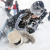 Alex Briggs, 15, gets her friend Sam Bartle, 15, in the snow during the snowball fight organized by Broomfield High School students at the Broomfield County Commons on Thrusday<br /> <br /> October 29, 2009<br /> Staff photo/David R. Jennings