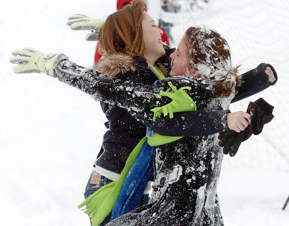 Taylor Ryan, 15, left, hugs Skyler Ellis, 15, during the snowball fight organized by Broomfield High School students at the Broomfield County Commons on Thursday<br /> <br /> October 29, 2009<br /> Staff photo/David R. Jennings