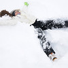 Kayleen Campbell, 16, makes a snow angel before the snowball fight organized by Broomfield High School students at the Broomfield County Commons on Thursday.<br /> <br /> October 29, 2009<br /> Staff photo/David R. Jennings