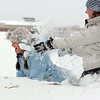 Brittney Zec, 15, left, gets hit with snow by Elizabeth Belton, 16,  during the snowball fight organized by Broomfield High School students at the Broomfield County Commons on Thursday<br /> <br /> October 29, 2009<br /> Staff photo/David R. Jennings