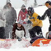 One team of high schoolers sets up a fort with sleds during the snowball fight organized by Broomfield High School students at the Broomfield County Commons on Thursday<br /> <br /> October 29, 2009<br /> Staff photo/David R. Jennings