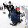 Jacob Stauf, 15, holds a sled as a shield for Dan Leurck, 15, to advance on the other team during the snowball fight organized by Broomfield High School students at the Broomfield County Commons on Thursday<br /> <br /> October 29, 2009<br /> Staff photo/David R. Jennings