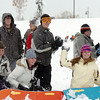 One team throws snowballs from behind their sled fort during the snowball fight organized by Broomfield High School students at the Broomfield County Commons on Thursday<br /> <br /> October 29, 2009<br /> Staff photo/David R. Jennings