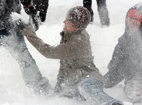 Eddie Decrescenzo, 13, is pelted with snowballs during the snowball fight organized by Broomfield High School students at the Broomfield County Commons on Thursday<br /> <br /> October 29, 2009<br /> Staff photo/David R. Jennings