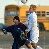 Holy Family's Zachary Burk does a header against Liberty's Brad Knab during Friday's state playoff game at Mike G. Gabriel Stadium.<br /> October 25, 2012<br /> staff photo/ David R. Jennings