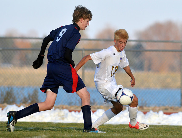 Holy Family's Nate Dalton takes control of the ball against Liberty's Troy Belleville during Friday's state playoff game at Mike G. Gabriel Stadium.<br /> October 25, 2012<br /> staff photo/ David R. Jennings