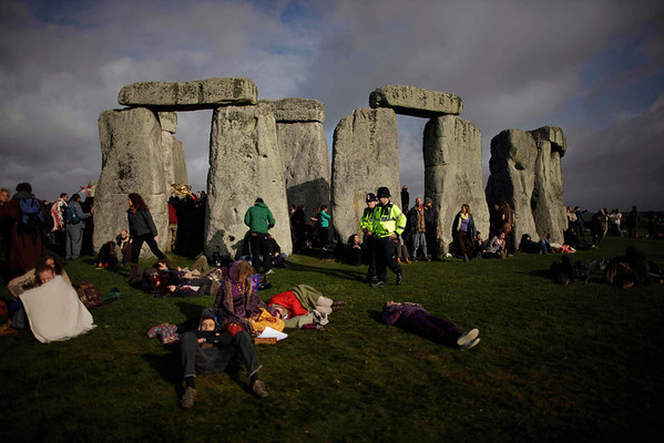 Britain Stonehenge .JPEG-0c.JPG British police officers walk amongst revellers attending the summer solstice at Stonehenge, near Salisbury in England, Tuesday, June 21, 2011.  The ancient stone circle of Stonehenge is a World Heritage Site erected between approximately 3000BC and 1600BC and despite years of research the reason behind its construction remains a mystery. The summer solstice in the northern hemisphere occurs annually on June 21 and is the time at which the sun is at its northernmost point in the sky.  (AP Photo/Matt Dunham)