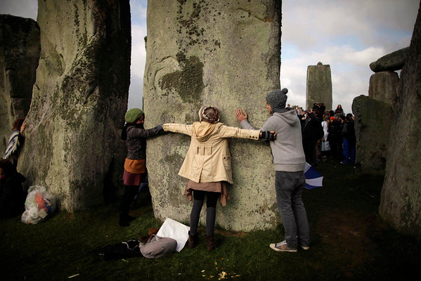 Britain Stonehenge.JPEG-0d4.JPG Revellers hug a stone during the summer solstice at Stonehenge, near Salisbury in England, Tuesday, June 21, 2011.  The ancient stone circle of Stonehenge is a World Heritage Site erected between approximately 3000BC and 1600BC and despite years of research the reason behind its construction remains a mystery. The summer solstice in the northern hemisphere occurs annually on June 21 and is the time at which the sun is at its northernmost point in the sky.  (AP Photo/Matt Dunham)
