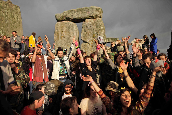 APTOPIX Britain Stonehenge.JPG Revellers cheer as the sun finally breaks through the clouds more than a couple of hours after sunrise during the summer solstice at Stonehenge, near Salisbury in England, Tuesday, June 21, 2011.  The ancient stone circle of Stonehenge is a World Heritage Site erected between approximately 3000BC and 1600BC and despite years of research the reason behind its construction remains a mystery. The summer solstice in the northern hemisphere occurs annually on June 21 and is the time at which the sun is at its northernmost point in the sky.  (AP Photo/Matt Dunham)