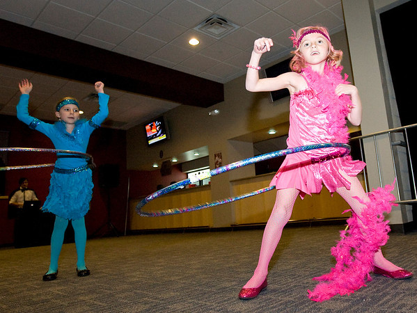 Ava Merias, age 7, right, and Anna Giles, age 7, practice their hula skills during the Spooktacular event at the Broomfield First Bank Center on Saturday.<br /> <br /> photo/ Matt Kelley