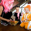 Beth Bernardi, left, prepares her grandchildren for action during the Spooktacular event at the Broomfield First Bank Center on Saturday. Lily Kis, center, age 3, and Donovan Jarvis, age 2. <br /> <br /> photo/ Matt Kelley