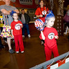 Kady Killion, age 5, tries her hand at throwing a football for prizes during the Spooktacular event at the Broomfield First Bank Center on Saturday. At left is dad Rick, sister Bridget, age 6 and mom Lois. <br /> <br /> photo/Matt Kelley